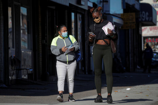Members of New York City Test and Trace Corps hand out masks and information leaflets about coronavirus disease (COVID-19) in the Borough Park section of Brooklyn, New York