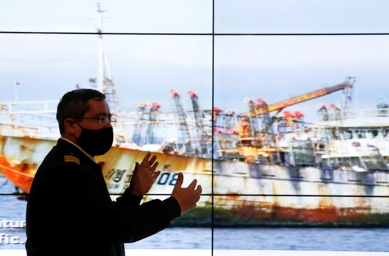 Chile's Commander Rodrigo Lepe, Chief of the fishing department of the maritime territory, shows a ship as a part of a large fleet of Chinese fishing vessels, who Chilean government is keeping tabs, while fishing along the Pacific Coast of South America.