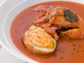 Bowl of Lobster Bisque Rouille Croute and Sliced Truffle