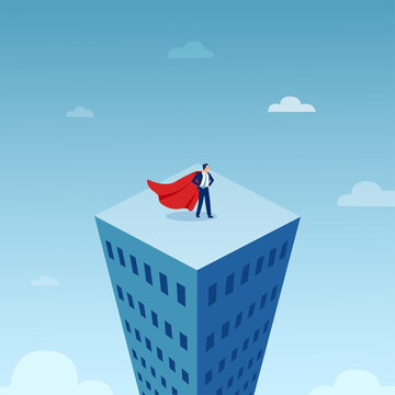 Vector of a business man in red cape on top of the tall city building