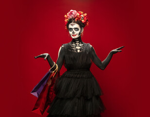 Photo sur Plexiglas Dinosaurs Shopping. Young girl like Santa Muerte Saint death or Sugar skull with bright make-up. Portrait isolated on red studio background with copyspace. Celebrating Halloween or Day of the dead. Black friday