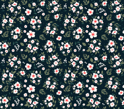 Trendy seamless vector floral pattern. Endless print made of small white flowers and dark green leaves . Summer and spring motifs. Black background. Vector illustration.