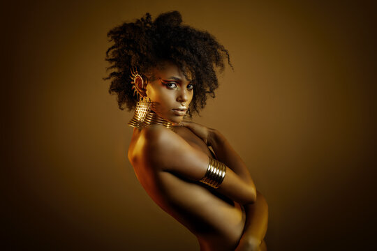 Colorful portrait of a beautiful afro girl wearing gold jewelry