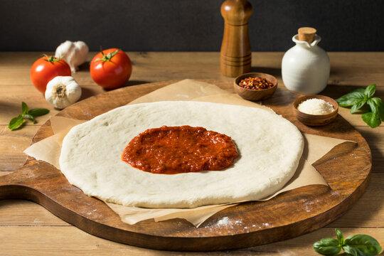 Preparing Homemade Uncooked Cheese PIzza