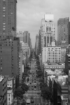 View through completely manhatten an endless canyon of houses with streets and the new york traffic. great view through the high skyscrapers. black and white picture