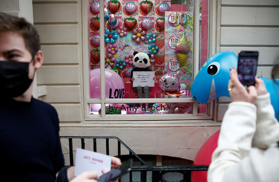 An interactive art installation called JOY Found Me, by Amy Broch, is seen in the window of a building in Mayfair, London