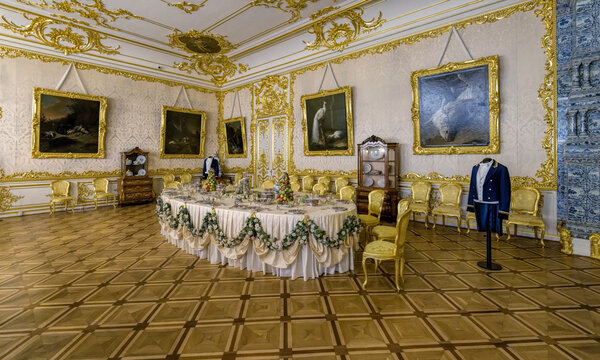 Ornate interior of the Catherine Palace in Tsarskoe Selo. White State Dining Room by Rastrelli formerly intended for grand banquets and also evening meals. St.Petersburg, Russia.