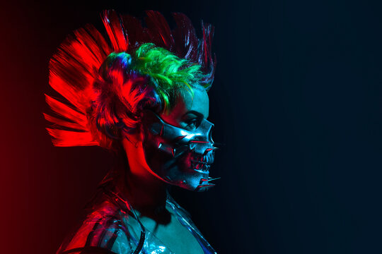 Profile view portrait of cyberpunk woman with mohawk hairstyle and spiked skull mask.