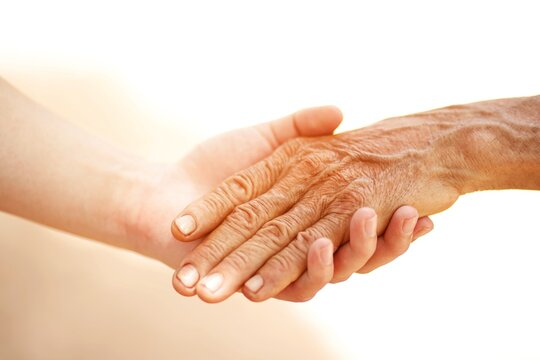 elderly and young person holding hands Helping , care and respect.