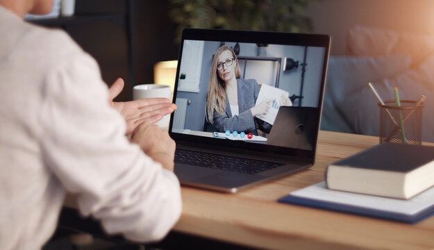 Back view of impersonalized person having distant communication with business partner through video call