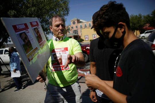 Robert Halliday hands out posters with the image of her missing son Richard Halliday, an American soldier who according to his family is missing since July 23, 2020 and they believe he crossed into Mexico, in Ciudad Juarez