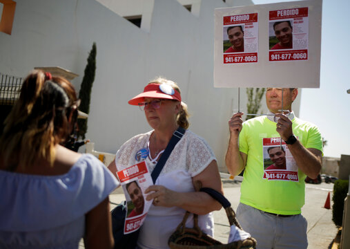 Patricia and Robert Halliday hand out posters with the image of their missing son Richard Halliday, an American soldier who according to his family is missing since July 23, 2020 and they believe he crossed into Mexico, in Ciudad Juarez