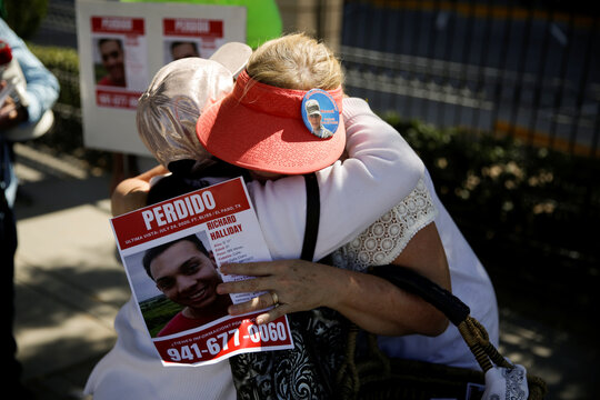 Patricia Halliday gets a hug while handing out posters with the image of her missing son Richard Halliday, an American soldier who according to his family is missing since July 23, 2020 and they believe he crossed into Mexico, in Ciudad Juarez