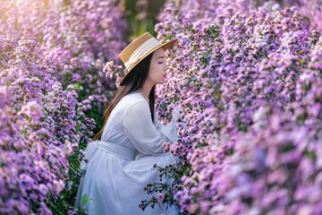 Wall Mural - Beautiful girl in white dress sitting in Margaret flowers fields.