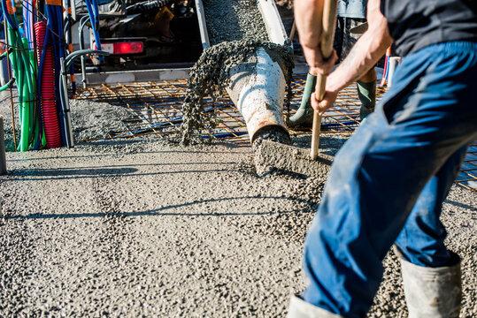 mixer truck pouring concrete on the construction site