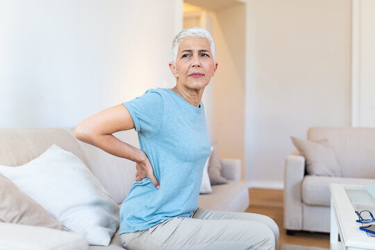 Matur Woman suffering from lower back pain. Mature woman resting with back pain. Female lower back pain. Senior woman injury suffering from backache, Spine in 3d