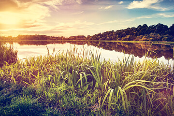 Lake at sunset. Countryside rural scenery in Poland