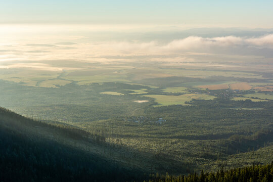 Lowland landscape and morning fog. View from the slopes of the Tatra Mountains.