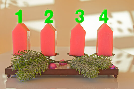 Christmas candles with numbers from 1 to 4 against bright background