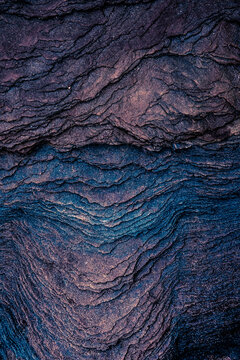 Colourful sedimentary rocks formed by the accumulation of sediments – natural rock layers backgrounds, patterns and textures - abstract graphic design – geology – nature formations