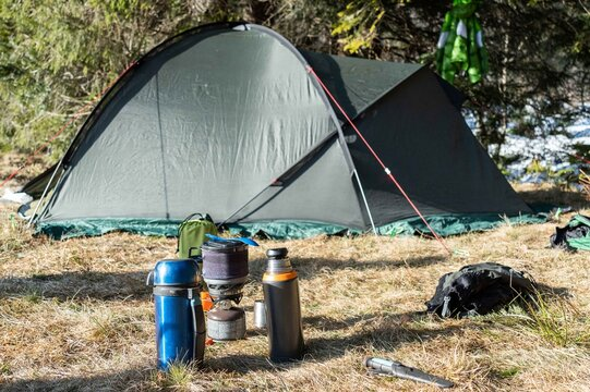Morning at the campsite. Preparing breakfast in basecamp. Tourist tent and kitchen.