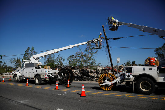 Workers fix communication lines after Hurricane Delta, in Lake Charles