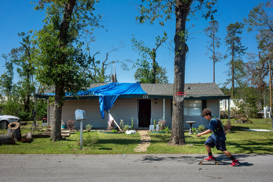 Eathen Marshall, 16, skateboards in front of his house after Hurricane Delta passed through Moss Bluff