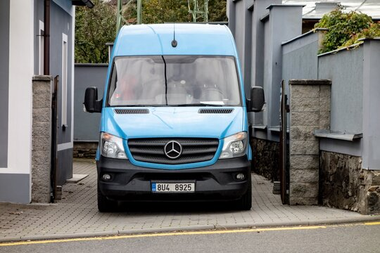 Frontal part of blue Mercedes-Benz Sprinter commercial van which is used for delivering goods