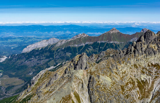 Late summer landscape of peaks and valleys seen from a peak in the Tatra Mountains, Slovakia.