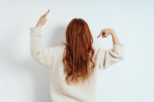 Young woman with long tousled red hair