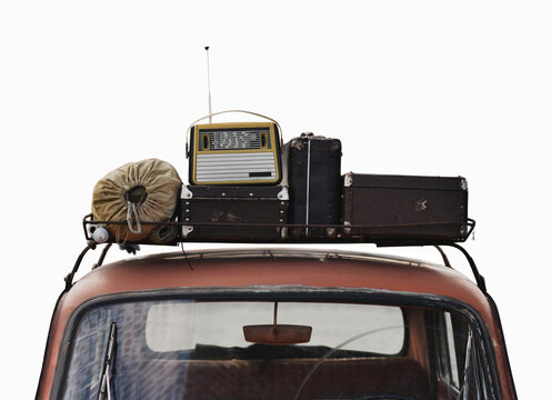 suitcases and radio on roof rack car in retro style isolated on white background