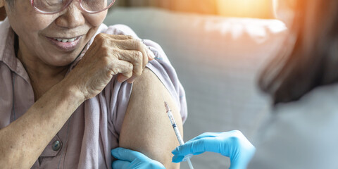 Vaccine shot for elderly vaccination, medical immunization for aging senior woman, older patient,...