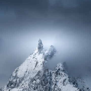 Snowing peak on french alps