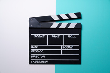 movie clapper on white and green table background ; film, cinema and video photography concept