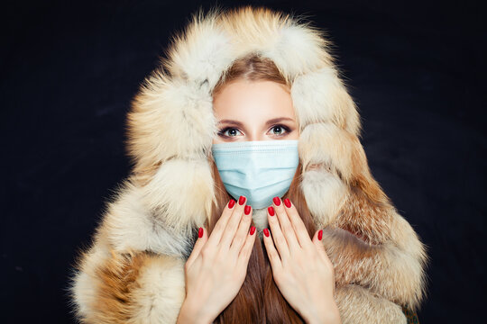Winter woman in protective medical mask on black background