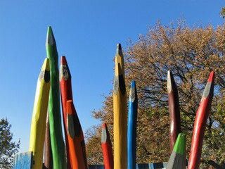Wall Murals Fantasy Landscape Playground with giant wooden colored pencils in the park of the Gellért hill in october in Budapest, Hungary