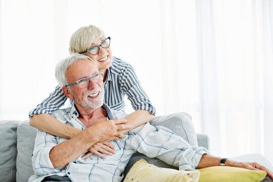 senior couple love together happy hug home family elderly man woman retirement smiling