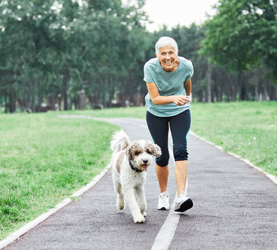 outdoor senior fitness woman lifestyle active sport exercise healthy dog pet love jogging running