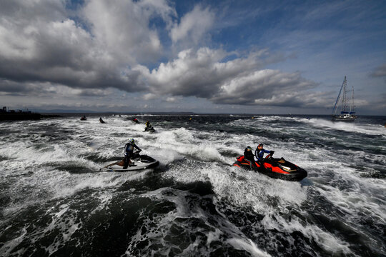 People ride on jet skis during the motorbike and water sports festival in Vladivostok