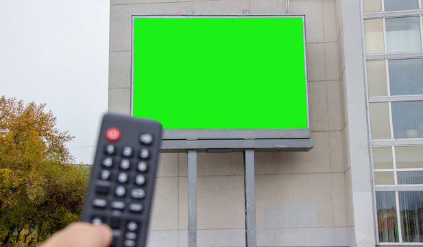 the advertising screen on the street is switched from the remote control. selective focus.