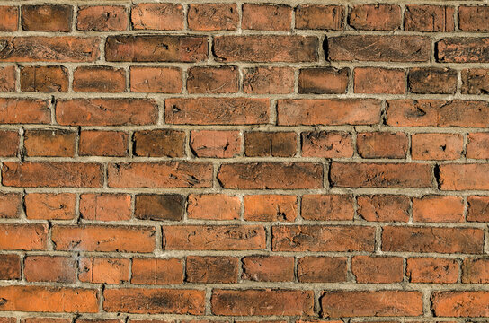 Red weathered brick wall background