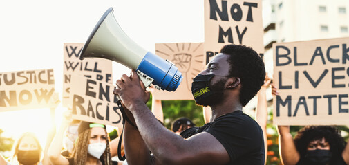 Fototapeta Activist movement protesting against racism and fighting for equality - Demonstrators from different cultures and race protest on street for equal rights - Black lives matter protests city concept obraz