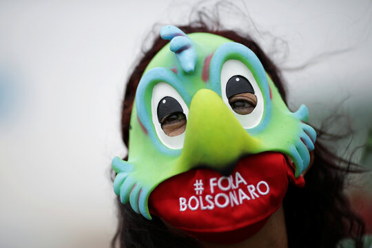 A demonstrator takes part in a protest against Brazil's President Jair Bolsonaro and racism, in Brasilia