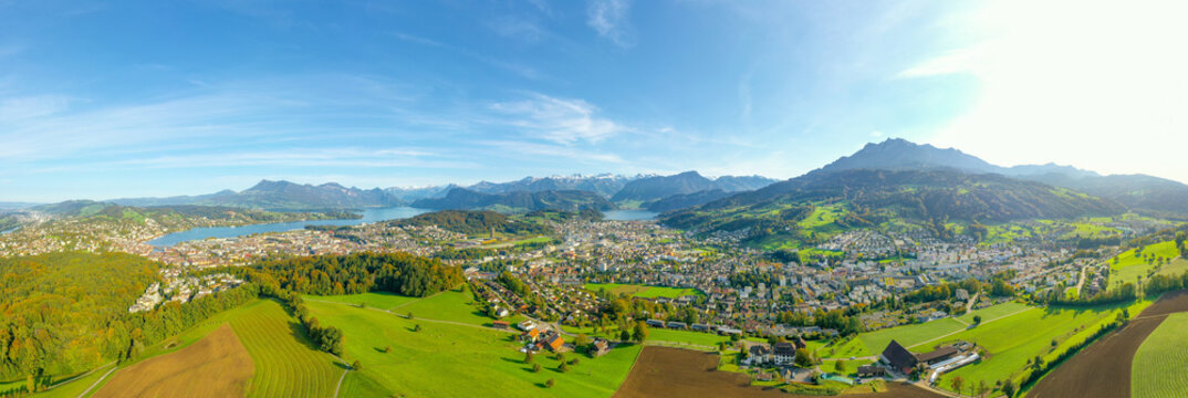 Wide panorama of the canton of Lucerne. Switzerland. Pilatus peak. Aerial view. City skyline and village landscape
