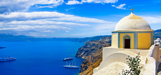 Iconic Santorini - most beautiful island in Europe. view with traditional churches in Fira village. Greece