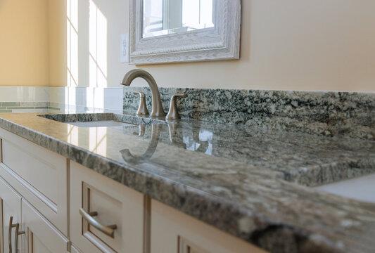 Modern grey marble countertop designer bathroom with sinks bathtub