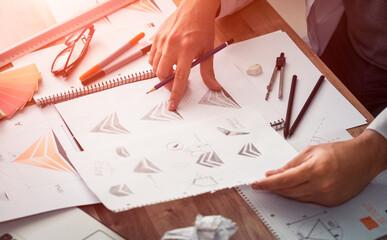 Photo sur Plexiglas Dinosaurs Graphic designer drawing sketches logo design.