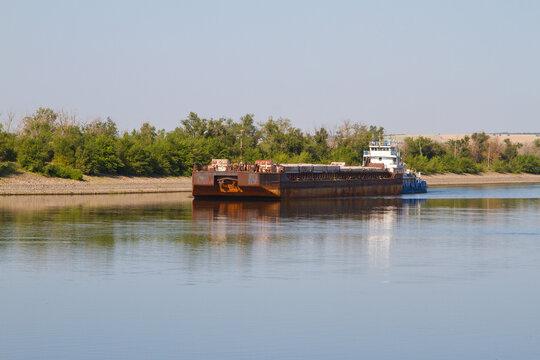 Cargo ship moving along the river