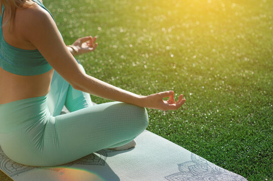 Girl alone at the stadium doing yoga asanas
