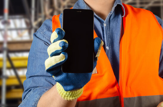 Worker male in uniform holding smartphone.